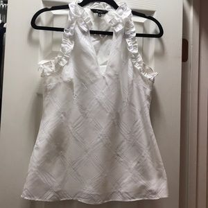 White sleeveless top with ruffle detail